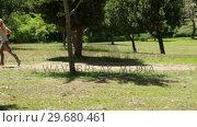 Купить «A woman runs down a footpath in the park», видеоролик № 29680461, снято 17 ноября 2011 г. (c) Wavebreak Media / Фотобанк Лори