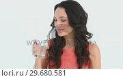 Купить «Young adult drinks a glass of water», видеоролик № 29680581, снято 11 ноября 2011 г. (c) Wavebreak Media / Фотобанк Лори