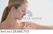 Blonde woman massaging her arm. Стоковое видео, агентство Wavebreak Media / Фотобанк Лори