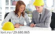 Купить «Serious architect working on blueprints», видеоролик № 29680865, снято 22 ноября 2011 г. (c) Wavebreak Media / Фотобанк Лори