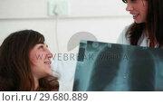 Купить «Patient looking at an xray scan», видеоролик № 29680889, снято 22 ноября 2011 г. (c) Wavebreak Media / Фотобанк Лори