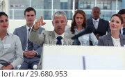 Купить «Grey haired man asking a question», видеоролик № 29680953, снято 22 ноября 2011 г. (c) Wavebreak Media / Фотобанк Лори