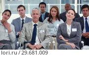 Купить «People at a business conference», видеоролик № 29681009, снято 22 ноября 2011 г. (c) Wavebreak Media / Фотобанк Лори