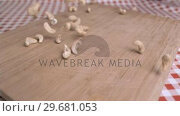 Купить «Cashew nuts being poured in super slow motion», видеоролик № 29681053, снято 24 февраля 2012 г. (c) Wavebreak Media / Фотобанк Лори