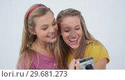 Купить «Friends taking a photo of themselves », видеоролик № 29681273, снято 23 ноября 2011 г. (c) Wavebreak Media / Фотобанк Лори