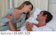 Купить «Woman in love holding her husbands hand», видеоролик № 29681529, снято 25 ноября 2011 г. (c) Wavebreak Media / Фотобанк Лори