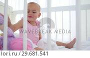 Купить «Baby girl playing with dolls», видеоролик № 29681541, снято 25 ноября 2011 г. (c) Wavebreak Media / Фотобанк Лори