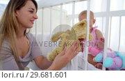 Купить «Mother watching her daughter playing with dolls», видеоролик № 29681601, снято 25 ноября 2011 г. (c) Wavebreak Media / Фотобанк Лори
