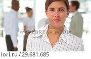 Well dressed woman looking at the camera. Стоковое видео, агентство Wavebreak Media / Фотобанк Лори