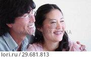 Купить «Man and a woman smiling as they hold each other», видеоролик № 29681813, снято 25 ноября 2011 г. (c) Wavebreak Media / Фотобанк Лори