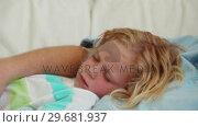 Купить «Father sleeping with his son next to him», видеоролик № 29681937, снято 25 ноября 2011 г. (c) Wavebreak Media / Фотобанк Лори