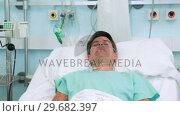 Купить «Grey hair patient with an oxygen nasal tube», видеоролик № 29682397, снято 25 апреля 2012 г. (c) Wavebreak Media / Фотобанк Лори