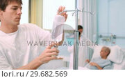Купить «Pregnant woman lying on a bed while a doctor is talking to her», видеоролик № 29682569, снято 24 апреля 2012 г. (c) Wavebreak Media / Фотобанк Лори