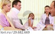 Купить «Injured woman talking to a doctor in the waiting room», видеоролик № 29682669, снято 27 апреля 2012 г. (c) Wavebreak Media / Фотобанк Лори