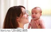 Купить «Happy mother holding a new born baby», видеоролик № 29682805, снято 27 апреля 2012 г. (c) Wavebreak Media / Фотобанк Лори