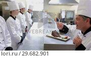 Купить «Head chef showing new desert to chefs», видеоролик № 29682901, снято 1 августа 2012 г. (c) Wavebreak Media / Фотобанк Лори