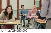 Купить «Class listening to lecturer while sitting », видеоролик № 29683005, снято 25 июля 2012 г. (c) Wavebreak Media / Фотобанк Лори