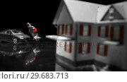 Купить «Black toy car hitting a woman figurine», видеоролик № 29683713, снято 3 декабря 2012 г. (c) Wavebreak Media / Фотобанк Лори