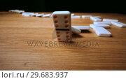 Купить «The domino effect on wooden table», видеоролик № 29683937, снято 7 февраля 2013 г. (c) Wavebreak Media / Фотобанк Лори