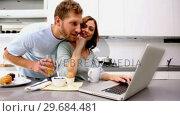 Купить «Woman showing her partner something on laptop», видеоролик № 29684481, снято 29 марта 2013 г. (c) Wavebreak Media / Фотобанк Лори