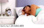 Купить «Woman waking up and going back to sleep», видеоролик № 29684489, снято 2 апреля 2013 г. (c) Wavebreak Media / Фотобанк Лори