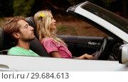 Купить «Couple in a comfortable car», видеоролик № 29684613, снято 6 апреля 2013 г. (c) Wavebreak Media / Фотобанк Лори