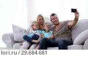 Купить «Father taking self portrait of him with family», видеоролик № 29684681, снято 27 марта 2013 г. (c) Wavebreak Media / Фотобанк Лори