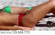 Купить «Attractive young women sunbathing on the beach», видеоролик № 29684773, снято 4 апреля 2013 г. (c) Wavebreak Media / Фотобанк Лори