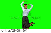 Купить «Happy businesswoman raising arms on green screen», видеоролик № 29684861, снято 7 апреля 2013 г. (c) Wavebreak Media / Фотобанк Лори