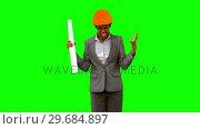 Купить «Happy architect raising arms on green screen», видеоролик № 29684897, снято 7 апреля 2013 г. (c) Wavebreak Media / Фотобанк Лори