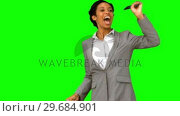 Купить «Cheerful woman waving at someone on green screen», видеоролик № 29684901, снято 7 апреля 2013 г. (c) Wavebreak Media / Фотобанк Лори