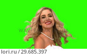 Купить «Pretty woman tossing her hair on green screen», видеоролик № 29685397, снято 8 апреля 2013 г. (c) Wavebreak Media / Фотобанк Лори