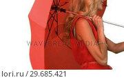 Купить «Pretty woman holding an umbrella on white screen», видеоролик № 29685421, снято 8 апреля 2013 г. (c) Wavebreak Media / Фотобанк Лори