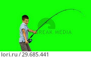 Купить «Little boy fishing on green screen», видеоролик № 29685441, снято 6 апреля 2013 г. (c) Wavebreak Media / Фотобанк Лори