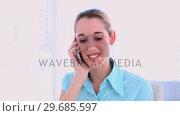 Купить «Stylish content businesswoman phoning», видеоролик № 29685597, снято 17 июля 2013 г. (c) Wavebreak Media / Фотобанк Лори
