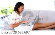 Купить «Young dark haired woman working with her laptop», видеоролик № 29685697, снято 14 июня 2013 г. (c) Wavebreak Media / Фотобанк Лори