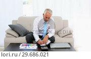 Купить «Businessman writing in his diary and smiling at camera», видеоролик № 29686021, снято 26 августа 2013 г. (c) Wavebreak Media / Фотобанк Лори