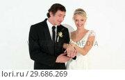 Newlyweds admiring their wedding rings. Стоковое видео, агентство Wavebreak Media / Фотобанк Лори