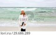 Купить «Retired woman walking by the sea», видеоролик № 29686289, снято 11 октября 2013 г. (c) Wavebreak Media / Фотобанк Лори