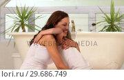 Little girl giving her mother a hug and kiss. Стоковое видео, агентство Wavebreak Media / Фотобанк Лори