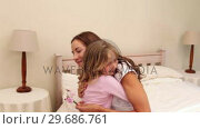 Little girl giving her mother wild flowers. Стоковое видео, агентство Wavebreak Media / Фотобанк Лори