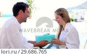 Купить «Handsome man surprising his girlfriend with a gift», видеоролик № 29686765, снято 17 декабря 2013 г. (c) Wavebreak Media / Фотобанк Лори