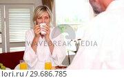Купить «Happy couple having breakfast together», видеоролик № 29686785, снято 6 декабря 2013 г. (c) Wavebreak Media / Фотобанк Лори