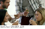 Купить «Happy couple toasting together», видеоролик № 29687221, снято 16 декабря 2015 г. (c) Wavebreak Media / Фотобанк Лори