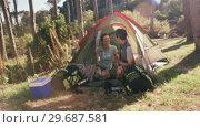 Купить «Happy couple having cup of coffee in tent», видеоролик № 29687581, снято 9 февраля 2016 г. (c) Wavebreak Media / Фотобанк Лори