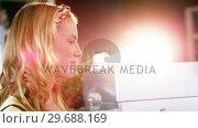 Купить «Woman paying bill through smartphone using NFC technology», видеоролик № 29688169, снято 30 мая 2016 г. (c) Wavebreak Media / Фотобанк Лори