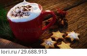 Купить «Coffee mug with christmas cookies on a plank», видеоролик № 29688913, снято 30 августа 2016 г. (c) Wavebreak Media / Фотобанк Лори