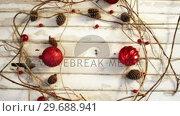 Купить «Christmas decorations on wooden plank», видеоролик № 29688941, снято 30 августа 2016 г. (c) Wavebreak Media / Фотобанк Лори