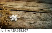 Купить «Star and snowflake on wooden plank», видеоролик № 29688957, снято 30 августа 2016 г. (c) Wavebreak Media / Фотобанк Лори