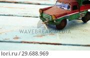 Купить «Toy tempo carrying christmas fir on wooden plank», видеоролик № 29688969, снято 30 августа 2016 г. (c) Wavebreak Media / Фотобанк Лори